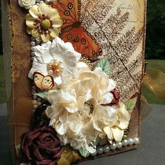 Just finished this beauty.  It's definitely got an Autumn inspired cover.  The inside has all the colors of summer flowers in full bloom.  It is such a joy to work with Tim Coffey paper.