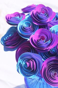 Ok - these are blue but I could see them in teal and purple.  Blue and Purple Reverse Paper Flowers - Stemmed - Bouquet Arrangement - Baby Shower - Centerpiece - Party Decor