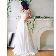 This off the shoulder wedding gown is romantic and sexy. The comfortable style can be replicated with any changes a bride needs.  We can produce any type of custom #weddingdresses you want or need.  Replicas are also an option.  Contact our American based dress company to see how much your favorite couture wedding gown will cost.
