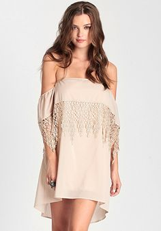 """Premonition Off Shoulder Dress In Cream $42.00 Cream-toned off-shoulder dress featuring a teardrop applique trim. Elasticity along the upper bust for comfortable fit. Fully lined.     -24"""" from top of bust  -100% Polyester   -Made in USA   -Model is wearing size small"""
