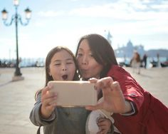 Stock Photo : Mother and daughter take funny faces selfie