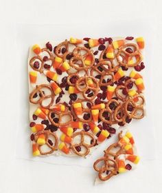 Candy Corn and Pretzel Bark|Making this delightful candy is a cinch—spread melted chocolate in a pan, top with candy corn, pretzels, and dried cranberries, and chill until set.