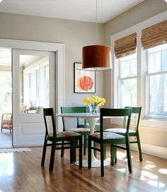 Benjamin Moore Stingray Wall Color, Round table with green chairs, orange pendant