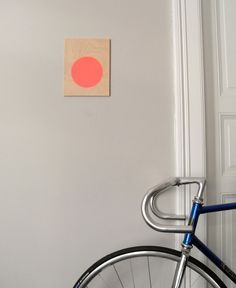 Circle screenprint on plywood, neon red - Sandra Thomsen
