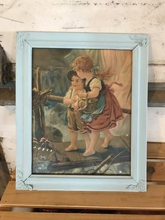Vintage old painting of a little boy and girl possibly a brother and sister with vivid colors and baby blue frame Nursery