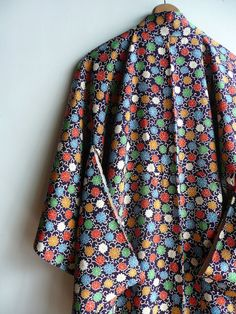 This kimono is made from delightfully soft fabric. Fibre unknown. Most likely silk but I cant say for sure. Colourful chrysanthemum flowers are