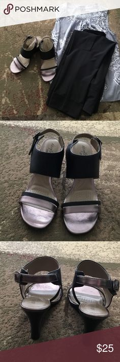 Black and taupe Dexflex Comfort shoes Beautiful shoe in black with taupe color in great condition.  Very comfortable and would add to your closet.  4 inch heel. Dexflex  Shoes Heels