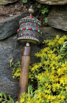 mummyduster:  This Buddhist prayer wheel contains a scroll inside the hollow metal cylinder with the mantra Om mani padme hum. Prayer wheelsare used primarily by the Buddhists of Tibet and  Nepal.  Spinning the wheel is considered by some to be just as effective as reciting the mantra aloud.