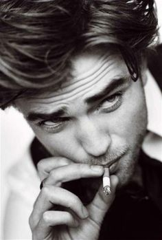 Rob Pattison - this is probably the first picture I've ever liked of him.  I love a B/W photo of a boy with a cigarette.