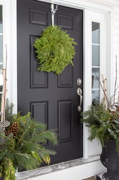 Christmas Porch with Black Door, Cedar Wreath and Fresh Christmas Urns