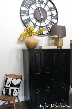 moore navajo white with entryway decor ideas including large overside metal clock and black armoire for storage Warm Paint Colors, Paint Colors For Living Room, Neutral Paint, Wall Colors, Gray Paint, Benjamin Moore Navajo White, Best White Paint, Traditional Paint, Metal Clock