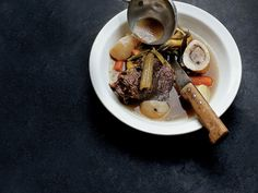 Classic Pot-au-Feu | For this dish, David Duband braises two cuts of beef—shank and rump roast—with marrow bones and then separately cooks leeks and carrots with more marr...