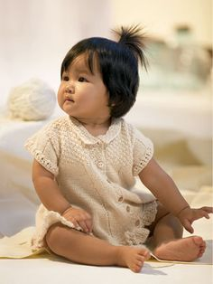 baby dress Design by Jo Lynne Murchland This little dress is an heirloom treasure with a pretty moss stitch bodice and a frilly ruffle along the hem.  Knit with Alpacas Silk or Royal from Blue Sky Alpacas.