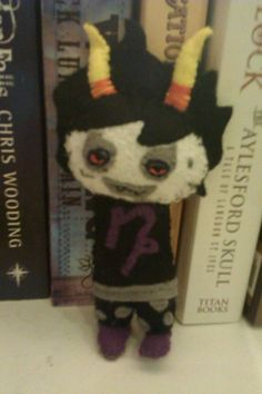 The utterly horrific Gamzee from Homestuck, brought to life in felt
