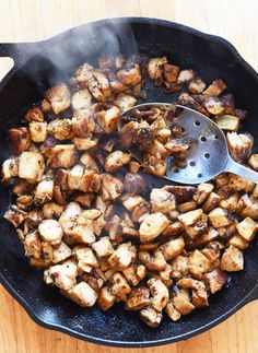 Return all the chicken to the skillet and cook it over medium-high heat until the little bits of chicken get all evenly coated and browned in the chipotle marinade, just a few minutes. | Here's How To Make Every Meat On The Chipotle Menu