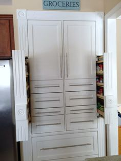 Beautiful built-in pantry, but the real cool thing is the awesome spice racks...you wouldn't even know they are there when they are closed!  Great use of space!