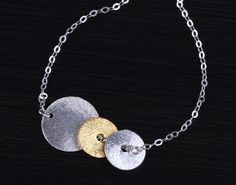 Two sterling silver discs with a gold vermeil disc are strung on a dainty sterling silver chain. * This listing is only for the bracelet. Bridal Bracelet, Mixed Metals, Troy, Silver Bracelets, Sterling Silver Chains, Bridesmaid Gifts, Gold, Jewelry, Silver Cuff Bracelets