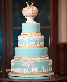 I'm obsessed with this pastel animal kingdom wedding cake. Photo: A La Vie / The Knot Blog