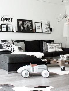 Our crisp white walls, couch, grey floor, coffee table, favorite black and white images, and go wild with coordinating pillows and accessories.. Norwegian Living Rooms by decor8, via Flickr #blackwhitedecor