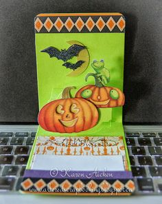 Karen Aicken using the A2 Pop 'n Cuts Base with included Circle Label Insert - Altered Scrapbooking: Pumpkins and Frogs