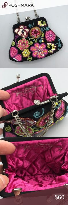"""Vera Bradley 25th Anniversary Coin Purse CUTE Miniature kiss lock evening/coin embroidered with flowers in vibrant colors on black. Extremely rare purse is in excellent unused condition. Vera Bradley, 25 Years embroidered in silver thread inside the bag is on its pink satin quilted lining. The beaded embroidery design is the same on front and back, and the silver tone kiss lock is adorned with a rhinestones. The silver chain is 4 1/2"""" long. The bag is very clean. A collector's item and will…"""