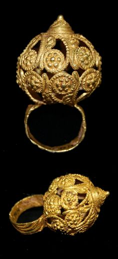 Africa | Lost wax casting in gold of a finger-ring (frumepu, frumoampun) surmounted by an elaborate open-work domed bezel terminating in a small raised conical boss. | Asante people, Ghana; probably from Kumase | 19th - 20th century || {7.15}