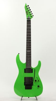 is a Electric Guitar Store specializing in ESP Guitars with a huge archive of ESP Guitars from Custom Shop, LTD, Rare to Wild, you will find Esp Guitars, Green Electric, Guitar Store, Schecter, Ibanez, Guitar Amp, Neon Green, Bass, Instruments