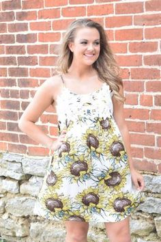 You're beautiful already, but put on this sunflower print dress and (wooooo)…