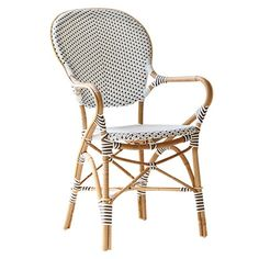 Our Isabelle  chairs are for covered areas outside in summertime but we especially like them for a spectacular indoor setting.  Paired with a reclaimed wood dining table, these chairs really come to life! #coastalchic #haveaseat #rattan