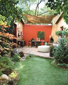 The bright orange back wall adds distinction to this space at the far end of a garden designed by Mark Haynes, Allied ASID. When choosing paint colors for outdoors, consider what the garden will look like in all four seasons, and make sure the hue you select will complement nature's palette all year long.