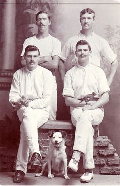 Four British men and their furry and feathered friends, Bangalore, India, circa 1910
