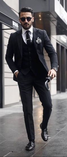 8a57493ac73 Men s Suits - Classic black three pice suit with a black knit tie white  button up