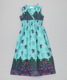 Designed and handcrafted in India, this darling dress shows off a one of a kind print. A smocked waistband makes it extra comfy and easy to slip on, while cotton ensures a soft and breathable fit.
