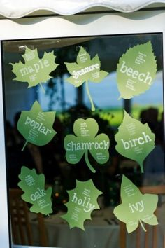 tree-themed tables. Cut out leaf pattern of each tree and write seating plan on the leaves. Instead of a number each table will be named after a tree.