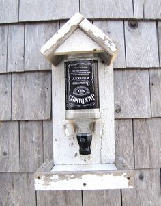 The birdies just love these feeders, plenty of room to forge on their favorite bird seed. Great feeder for the JACK fan. Just fill the bottle with Wood Bird Feeder, Bird House Feeder, Recycled Crafts, Wood Crafts, Deco Originale, Craft Sale, Bottle Crafts, Bird Houses, Wood Projects
