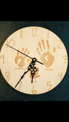 Your family's handprints on a birch wood clock. £20 https://www.etsy.com/shop/tinytoescraftcreate1