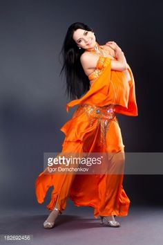Belly Dance Performance. Grey background.Arabic dance series