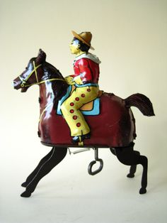 tin toy - horse and cowboy