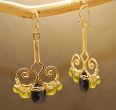 Hammered swirl drop earrings with peridot & black spinel Nouveau 65 (116.00 USD) by CalicoJunoJewelry