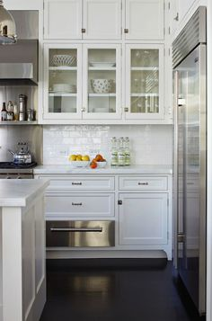 White Kitchen Cabinets with Stainless Steel Countertops - Contemporary - kitchen - House Beautiful Kitchen Redo, Kitchen And Bath, New Kitchen, Kitchen Remodel, Kitchen Dining, Kitchen Cabinets, White Cabinets, Glass Cabinets, Upper Cabinets