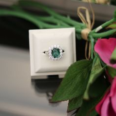 A mesmerising green Tourmaline cushion cut gemstone encompassed by an oversized halo of fine quality white Diamonds. Handcrafted in 18 carat white gold with Diamond set shoulders. Dress Rings, Green Tourmaline, White Diamonds, Cushion Cut, Jewelry Stores, Halo, Sapphire, Jewelry Design, White Gold