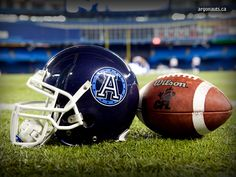 Just a nice photo of the team helmet and CFL ball on the turf at Rogers Centre. Rogers Centre, Canadian Football League, Football Pictures, Toronto Maple Leafs, Argos, Female Athletes, Football Helmets, Cool Photos, Hockey