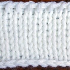 Don't let the name fool you. The Tunisian knit stitch isn't knitted; it's a crochet stitch. We call it the knit stitch because it resembles stockinette stitch.