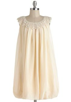 Cream dress with crocheted collar.  Springy!