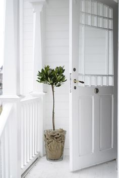 beautiful white porch- love the door