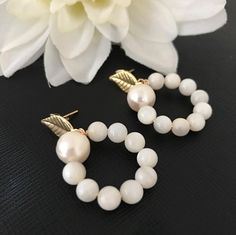 Handmade elegant and sophisticated earring with genuine pearls, evil eye black and gold plated 18 carats.One of the kind. by PathysDesign on Etsy
