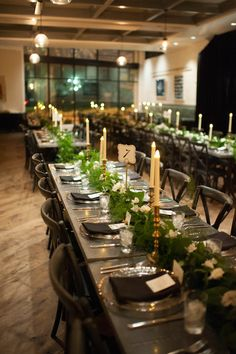 Long Feasting Tables with Candlelight and Elegant/Boho Garland Table Runners/Centerpieces and Wooden Church Chairs | Tampa Wedding Venue The Oxford Exchange