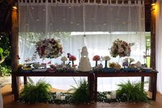 One of the tables in my wedding in Buzios, Brazil. Hanging candles, a lot of flowers and love everywhere. Dec 2015.