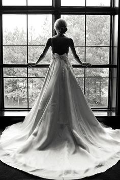 Gorgeous photo...especially if your dress has a unique back interest ~#repinned by Lori Cole for California Bridal Eventz