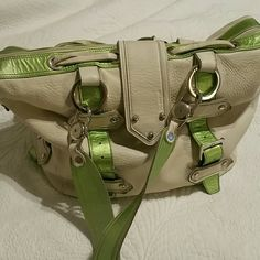 GORGEOUS Gustto Bag !!!! From Spain. Substantial cream leather with green metallic leather accents and handles.  Pristine except for some ink marks at very bottom of cotton lining, that are not visible without pulling out lining. I think they could be removed easily. Double shoulder straps, removable.  More pics available on request. TAKING OFFERS Gustto  Bags
